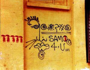 """Crearon el personaje SAMO© (del que se decía que representaba """"la misma mierda de siempre"""") y pintaron mensajes anónimos – """"SAMO©) UN PIN CAE COMO UN OLOR PUNGENTE…"""" y """"SAMO©…JUST IN CASE…""""- en paredes de los alrededores del SoHo y el East Village y en el tren D del metro de Nueva York."""